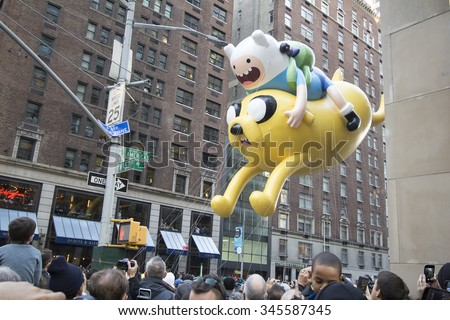 NEW YORK CITY, NY - NOVEMBER 26: Jake and Finn, from Adventure time, balloon in city for the Macy's 89th Annual Thanksgiving Day Parade on November 26, 2015 in New York City, New York.  - stock photo