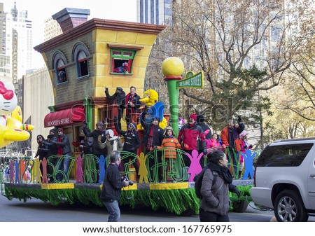 NEW YORK CITY, NY - NOVEMBER 28 : Jimmy Fallon and The Roots on Sesame Street float during the Macy's 87th Annual Thanksgiving Day Parade on November 28, 2013 in New York City, New York.  - stock photo