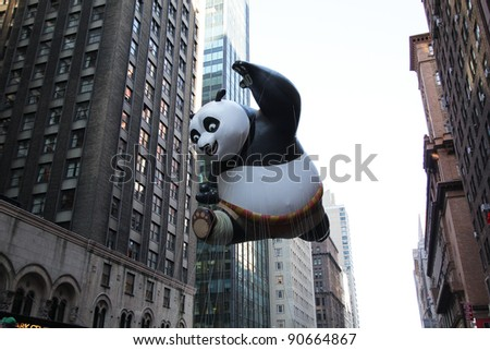 NEW YORK CITY, NY - NOVEMBER 24: Kung Fu Panda balloon float in the Macy's 85th Annual Thanksgiving Day Parade on November 24, 2011 in New York City, New York. - stock photo
