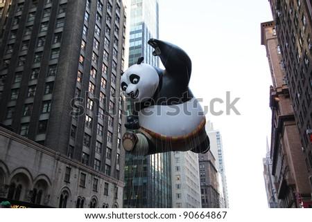 NEW YORK CITY, NY - NOVEMBER 24: Kung Fu Panda balloon float in the Macy's 85th Annual Thanksgiving Day Parade on November 24, 2011 in New York City, New York. - stock photo