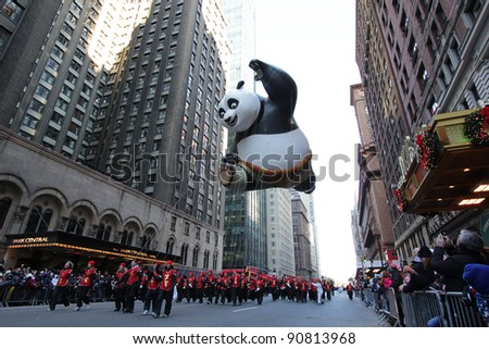 NEW YORK CITY, NY - NOVEMBER 24: Kung Fu Panda balloon floats in the Macy's 85th Annual Thanksgiving Day Parade on November 24, 2011 in New York City, New York. - stock photo
