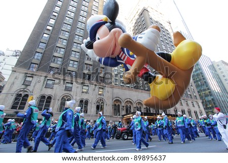 NEW YORK CITY, NY - NOVEMBER 24: Mickey Mouse balloon dressed as a Sailor during the Macy's 85th Annual Thanksgiving Day Parade on November 24, 2011 in New York City, New York. - stock photo