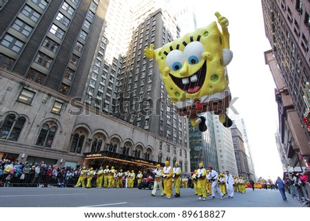 NEW YORK CITY, NY - NOVEMBER 24: Nickelodeon Sponebob Squarepants towers over people below in Macy's 85th Annual Thanksgiving Day Parade on November 24, 2011 in New York City, New York. - stock photo