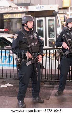 NEW YORK CITY, NY - NOVEMBER 26 : NYPD Strategic Response team in downtown Times Square on Thanksgiving evening November 26, 2015 in New York City, New York. - stock photo