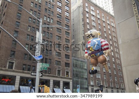 NEW YORK CITY, NY - NOVEMBER 26: Pirate balloon flying between buildings in city street during the 89th Annual Macy's Thanksgiving Day Parade on November 26, 2015 in New York City. - stock photo