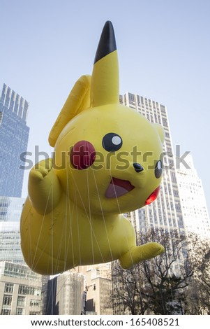 NEW YORK CITY, NY - NOVEMBER 28 : Pokemon's Pikachu flying through W 59th ST during the Macy's 87th Annual Thanksgiving Day Parade on November 28, 2013 in New York City, New York.  - stock photo