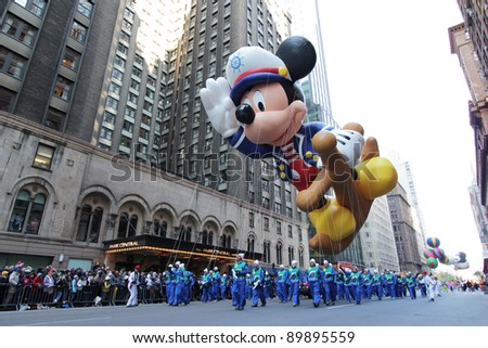 NEW YORK CITY, NY - NOVEMBER 24: Popular Cartoon Character Mickey Mouse balloon during the Macy's 85th Annual Thanksgiving Day Parade on November 24, 2011 in New York City, New York. - stock photo