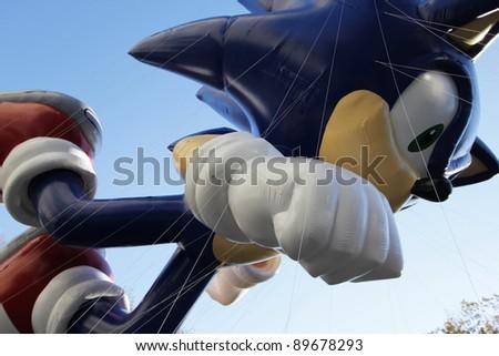 NEW YORK CITY, NY - NOVEMBER 24: Sega's Sonic The Hedgehog in sky during the Macy's 85th Annual Thanksgiving Day Parade on November 24, 2011 in New York City, New York. - stock photo