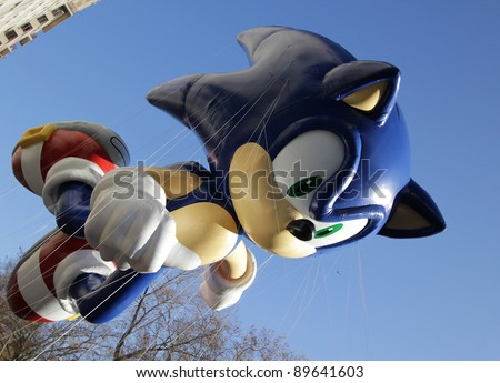 NEW YORK CITY, NY - NOVEMBER 24: Sega Sonic The Hedgehog flying through the city streets of the Macy's 85th Annual Thanksgiving Day Parade on November 24, 2011 in New York City, New York. - stock photo