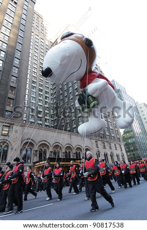 NEW YORK CITY, NY - NOVEMBER 24: Snoopy Balloon in the Macy's 85th Annual Thanksgiving Day Parade on November 24, 2011 in New York City, New York. - stock photo