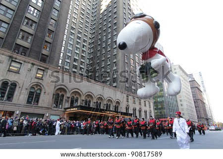 NEW YORK CITY, NY - NOVEMBER 24: Snoopy from Peanuts balloon floats in the Macy's 85th Annual Thanksgiving Day Parade on November 24, 2011 in New York City, New York. - stock photo