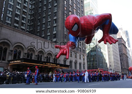 NEW YORK CITY, NY - NOVEMBER 24: Spider-man flying in city during the Macy's 85th Annual Thanksgiving Day Parade on November 24, 2011 in New York City, New York. - stock photo