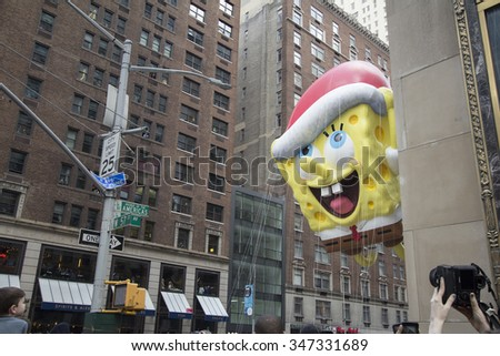 NEW YORK CITY, NY - NOVEMBER 26:Spongebob Square Pants Balloon flown through city street during the 89th Annual Macy's Thanksgiving Day Parade on November 26, 2015 in New York City. - stock photo