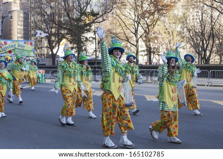 NEW YORK CITY, NY - NOVEMBER 28 : Waving clowns walking through W 59th ST during the Macy's 87th Annual Thanksgiving Day Parade on November 28, 2013 in New York City, New York.  - stock photo