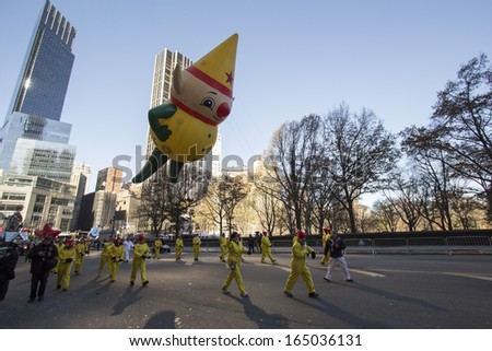 NEW YORK CITY, NY - NOVEMBER 28 : Yellow Elf Balloon going through W 59th ST during the Macy's 87th Annual Thanksgiving Day Parade on November 28, 2013 in New York City, New York.  - stock photo