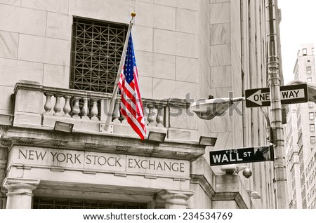 NEW YORK CITY, NY - OCT 11: A street sign of Wall Street and New York Stock Exchange is shown on October 11, 2013 in New York City. The Exchange building was built in 1903. - stock photo