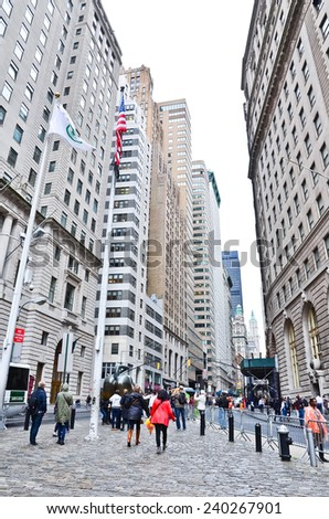 NEW YORK CITY, NY - OCT 11: The financial district of Wall Street on October 11, 2013 in New York City. Wall Street and Lower Manhattan is the busiest financial district in the world. - stock photo