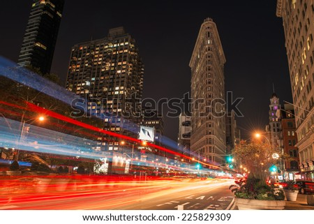 NEW YORK CITY, NY - OCTOBER 13: Flatiron Building at night on October 13, 2014 in New York City. Flatiron building designed by Chicago's Daniel Burnham was designated a New York City landmark in 1966. - stock photo
