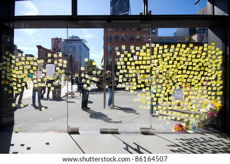 NEW YORK CITY, NY - OCTOBER 7: Sidewalk memorial and Post-it note farewells at the Apple Store in NYC on October 7, 2011 mark the death of Steve Jobs. The iconic CEO of Apple died Oct. 5th 2011. - stock photo