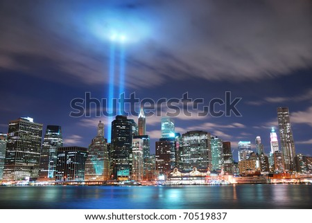 NEW YORK CITY, NY - SEP 2: Light beams are lit at the site in memory of World Trade Center destroyed on September 11. September 11, 2010 in Manhattan, New York City. - stock photo