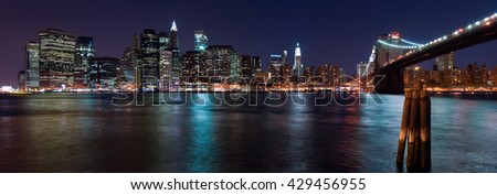 New York City, NY/USA - circa July 2008: Panorama of Brooklyn Bridge and Lower Manhattan by night