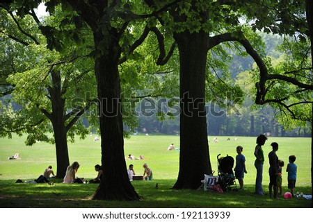 New York City, NY, USA - July 11 2009: Great Lawn sits In the center of Central Park, a green pasture of 55-acres that is considered one of the most famous lawns in the world, Manhattan - stock photo
