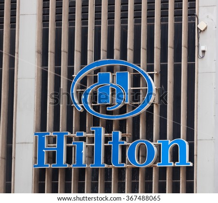 NEW YORK CITY, NY, USA - JULY 07, 2015: Sign of Hilton hotel at 6th Avenue in New York. Hilton is the 38th largest private company in the United States according to Forbes. - stock photo