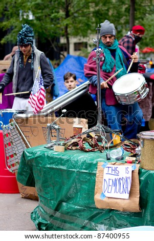 NEW YORK CITY - OCT. 21:  Band plays at the Occupy Wall Street demonstration in NYC's Zuccotti Park on Oct 21, 2011.  The protest began on Sept 17. - stock photo