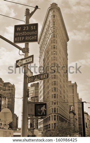 NEW YORK CITY - OCT 28: Historic Flatiron Building in NYC as seen on Oct 28, 20123 This iconic triangular building located in Manhattan's Fifth Ave was completed in 1902. - stock photo