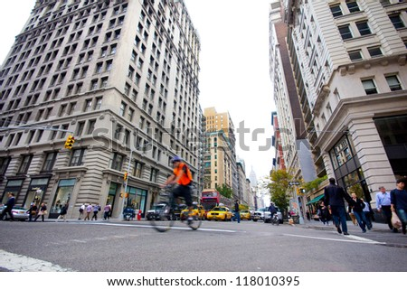 NEW YORK CITY - OCT 26: Intersection along historic Fifth Avenue in Manhattan on Oct. 26, 2012. 5th Ave. is a major thoroughfare in the center NYC with a stylish reputation and major retail district. - stock photo