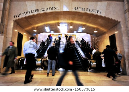 NEW YORK CITY - OCT 14:Passengers at the main concourse of the Grand Central Station Manhattan on October 14 2009 in Manhattan New York, USA.Grand Central Terminal turns 100 in 2013 - stock photo