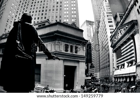 NEW YORK CITY - OCT 09 2010:Pedestrians pass by the New York Stock Exchange .In the aftermath of the September 11, 2001 terrorist attacks, the NYSE was closed for 4 trading sessions. - stock photo