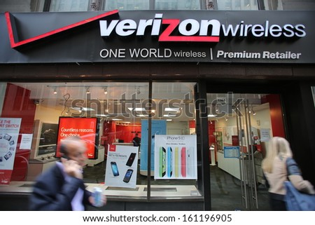 NEW YORK CITY - OCT 17:  Pedestrians walk past a Verizon Wireless retail outlet in Manhattan on Thursday, October 17, 2013.  - stock photo