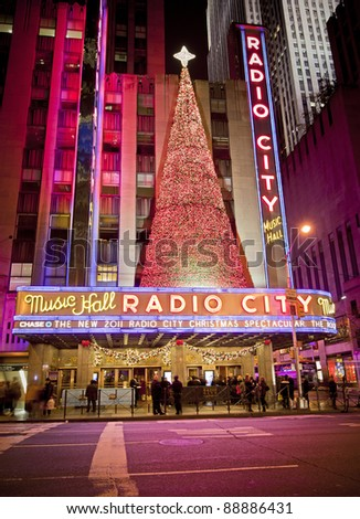 NEW YORK CITY - OCT 13: Radio City Music Hall, is the worlds largest indoor theater displaying this years Christmas tree decoration, October 13th, 2011 in Manhattan, New York City. - stock photo