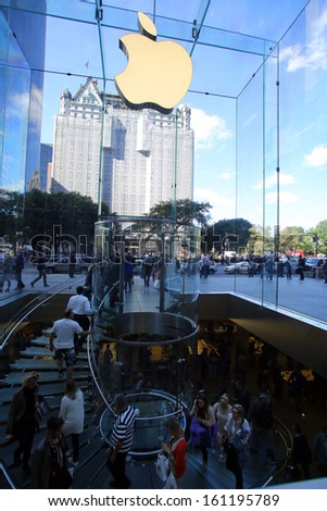 NEW YORK CITY - OCT 18, 2013: Shoppers arrive at the Apple Store on 5th Avenue in Manhattan on Friday, October 18, 2013.  - stock photo