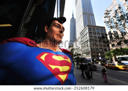 NEW YORK CITY - OCT 10 2009:Superman and the Empire State Building in New York City.Superman is an American cultural icon and has been labeled as the greatest comic book hero of all time by IGN - stock photo