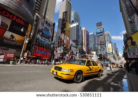 NEW YORK CITY - OCT 2, 2011: Times Square and yellow cabs wide angle photo in summer, New York City, USA