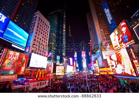 NEW YORK CITY - OCT 13: Times Square, is a busy tourist intersection of neon art and commerce and is an iconic street of New York City and America, October 13th, 2011 in Manhattan, New York City. - stock photo