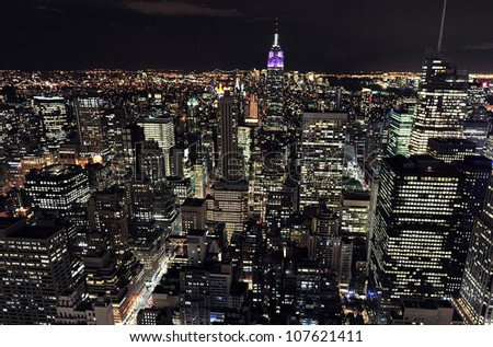 NEW YORK CITY - OCTOBER 13: Aerial view of Manhattan and the Empire State Building at night on October 13, 2009 in New York. The building is a 102-story landmark and American cultural icon in NYC.