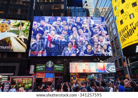 NEW YORK CITY - OCTOBER 06, 2015: big screen at Times Square with unidentified people. It is one of the worlds busiest pedestrian intersections and a major center of worlds entertainment industry - stock photo