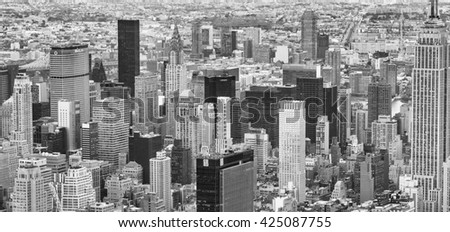 NEW YORK CITY - OCTOBER 22, 2015: City buildings and skyscrapers. New York is visited by 50 million people every year.