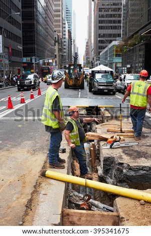 NEW YORK CITY - OCTOBER 15, 2014: construction workers doing repair work on supply lines in the underground of Madison Avenue - stock photo