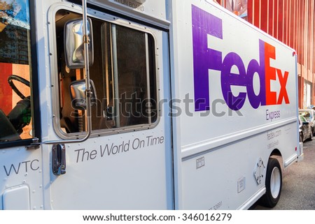 NEW YORK CITY - OCTOBER 06, 2015: FedEx van in Manhattan, NYC. FedEx Corporation is an American global courier delivery services company headquartered in Memphis, Tennessee - stock photo