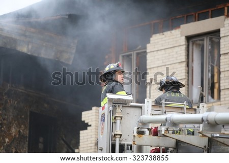 NEW YORK CITY - OCTOBER 3 2015: Fire companies, NYPD & other emergency response personnel gathered in Borough Park along with elected officials in the wake of an explosion that killed one & injured 13