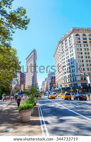 NEW YORK CITY - OCTOBER 10, 2015: Flatiron Building in Manhattan. Its a teel framed historical skyscraper, designated as NYC landmark and National Historic Landmark and registered in Historic Places  - stock photo