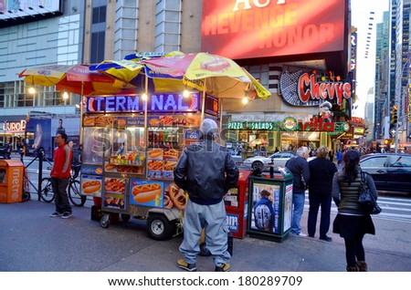 NEW YORK CITY OCTOBER 02, 2013: Food vending carts on the street in Manhattan. These mobile food carts require permits which in some cases exceed $200,000 a year. On october 02 2013 in NY USA. - stock photo