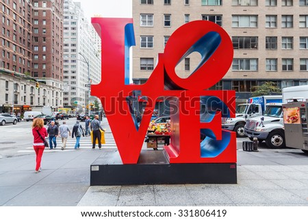 NEW YORK CITY - OCTOBER 07, 2015: Love sculpture in Midtown Manhattan with unidentified people. It is from artist Robert Indiana, a pop art artist, His media include paper and Cor-ten steel sculpture. - stock photo