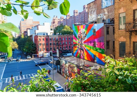 NEW YORK CITY - OCTOBER 12, 2015: mural from artist Kobra in Chelsea viewed from High Line. It based on Alfred Eisenstadts famous photograph V-J Day in Times Square published in Life Magazine in 1945 - stock photo