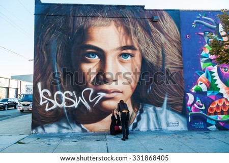 NEW YORK CITY - OCTOBER 10, 2015: mural in Bushwick, Brooklyn, with unidentified people. Bushwick is one of NYCs major street art hubs, with an outdoor art gallery known as the Bushwick Collective