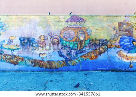 NEW YORK CITY - OCTOBER 11, 2015: mural of Os Gemeos in Coney Island. Os Gemeos are Brasilian twins, who are regarded as the most prominent representatives of the Brasilian street art
